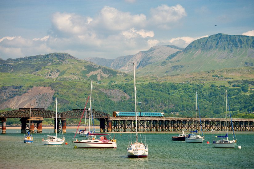 Train on Barmouth Bridge with Cadair Idris in background